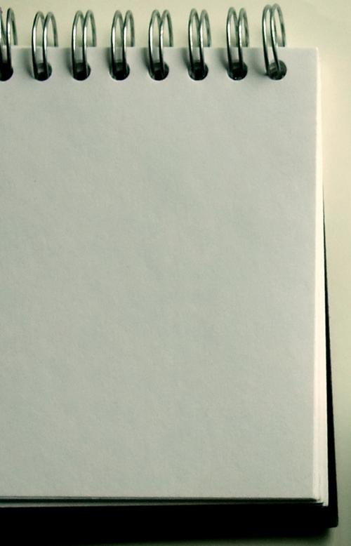 Cuaderno o libreta vertical con espiral de alambre arriba