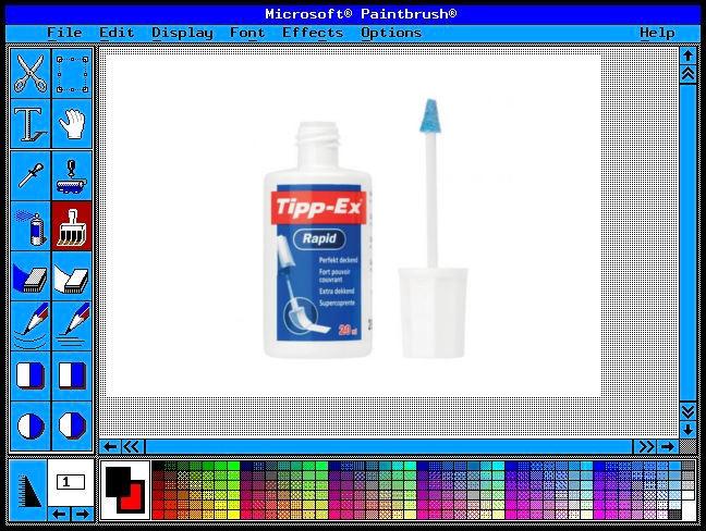paintbrush y bote de típex